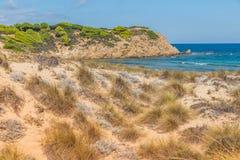 Deserted island. Sandy grass vegetation on deserted island. Skiathos, Greece 2018 royalty free stock images