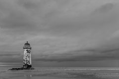Deserted Lighthouse. A Deserted Lighthouse on a Beach Processed in B&W Royalty Free Stock Photos
