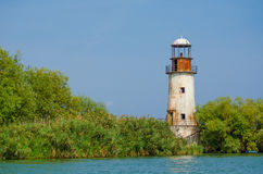 Deserted lighthouse. Old and deserted lighthouse on a sunny summer day Royalty Free Stock Images