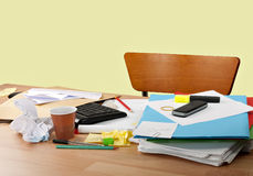 Deserted messy desk - overwork royalty free stock image