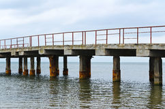 Deserted old bridge. rusty and unusable. ferroconcrete construct Stock Image