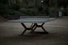 Deserted old table tennis table in an outdoor environment in low evening light Royalty Free Stock Photos