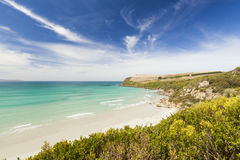Deserted paradise beach in Western Australia. Pristine environment with pure with sand and crystal clear water.  Located in a national park, the beach is a very Royalty Free Stock Photos