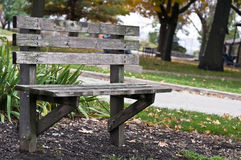 Deserted park bench Royalty Free Stock Photo