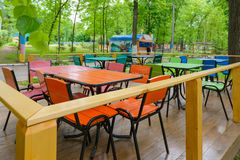 Deserted park cafe. Empty seats in a deserted park cafe Stock Images