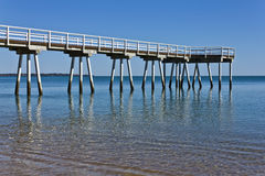 Deserted Pier. Deserted  on Hervey Bay,  Queensland Australia - conceptual suggesting peace, relaxation quiet Stock Image