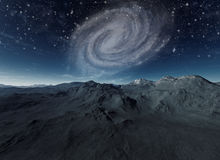Deserted planet with spiral galaxy in background. 3d rendered art: Deserted planet with spiral galaxy in background Stock Photo