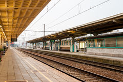 Deserted platform at the train station of Kortrijk. Stock Photos