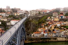 Deserted Ponte Dom Luis I bridge in Porto on rainy, foggy day royalty free stock image