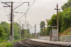 A deserted railway platform in the beginning of autumn, located royalty free stock images
