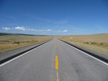 Deserted road. An empty road to nowhere. Through the high desert of Wyoming stock photos