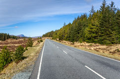 Deserted Road and Blue Sky in the Isle of Skye Stock Photo