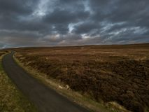 Deserted Road on the Moors. A deserted road on the north Yorkshire moors disappearing to the horizon stock photos