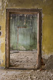 Deserted rooms. Interior of deserted, abandoned, damaged home Stock Image