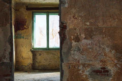 Deserted rooms. Interior of deserted, abandoned, damaged home Stock Images