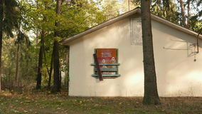 Deserted Russian first-aid post in kids camp. Autumn daytime. Smooth dolly shot.  stock footage