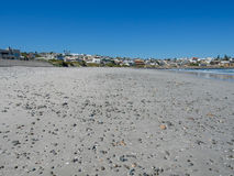 Deserted sand and pebble beach at Yzerfontein, South Africa.  Stock Photos