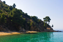 Deserted sandy beach with emerald green water in Sithonia Royalty Free Stock Image