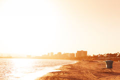 Deserted sea shore of Long Beach at sunset. Beautiful evening picture of deserted sea shore with buildings` silhouettes of Long Beach, California Royalty Free Stock Photos