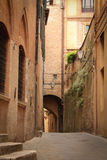 Deserted stone street of Italy. Deserted stone street in Sienna, Italy Royalty Free Stock Image