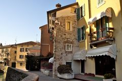 A deserted street in Sirmione. Old houses on a small deserted street of Sirmione on the Garda Lake. in Italy Stock Photo