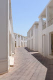 Deserted streets. Maze of identical white houses Stock Photography
