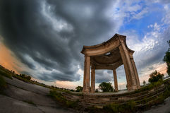 Deserted structure on the island located on Mill Lake Bucharest. Romania before a storm shot with fisheye in the evening Royalty Free Stock Image