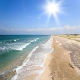 Deserted sunny beach Royalty Free Stock Photo