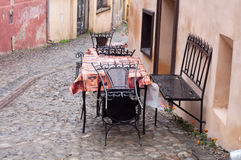 Deserted table after rain Stock Images