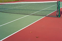 Deserted tennis court with net. A deserted tennis court with net divider Royalty Free Stock Photo