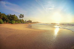 Deserted tropical beach. Serene sunrise on a tropical island paradise Royalty Free Stock Image