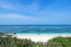 Deserted tropical island beach and clear blue water, Okinawa, Japan Stock Photo