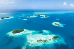 Deserted tropical paradise islands from above, Pal. Aerial image of deserted tropical islands, clear blue water and coral reefs, Palau, Micronesia stock image
