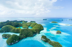 Deserted tropical paradise islands from above, Palau. Aerial image of deserted tropical islands, clear blue water and coral reefs, Seventy Islands of Palau royalty free stock photos