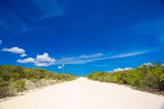 Deserted tropical road with white sand on Stock Images