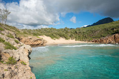 Deserted turquise beach. Turquise water on an empty beach in Hawaii Stock Photo