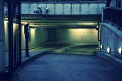 Deserted underground parking lot stock photo