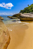 Deserted and unspoilt beach. With its limpid and transparent waters that meet the rainforest Royalty Free Stock Photo