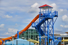 Deserted water slide at the end of summer vacation. Abandoned water park after all the children returned to school from summer vacation Stock Photo