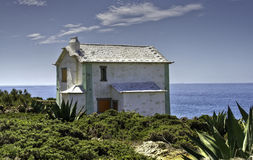 Deserted White Building By The Sea Stock Image