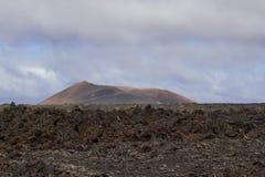 Desertera det vulkaniska landskapet för stenen i Lanzarote, kanariefågelöar Royaltyfri Foto