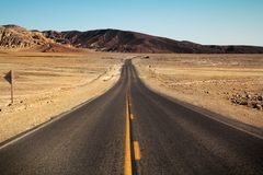 Desertic road to nowhere Stock Photo