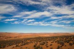 Deserto e céu azul Imagens de Stock Royalty Free