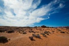 Deserto e céu azul Fotografia de Stock Royalty Free