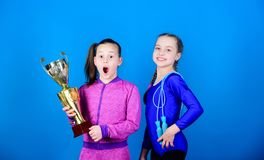 Deserved award. Sport achievement. Girls athletic kids celebrate victory. Athletic girls with golden goblet. Win. Championship. Our team first place. Children stock photography