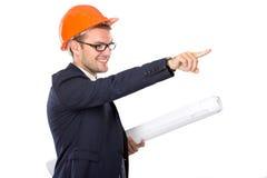 Desgaste novo do homem de negócios um capacete de segurança que aponta seu dedo Fotografia de Stock