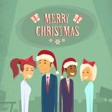 Desgaste Santa Hat Merry Christmas dos empresários Fotografia de Stock