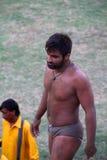 Desi Wrestler. SIALKOT, PAKISTAN - JUNE 17: Local Traditional Wrestler walking towards ring for his fight at Sialkot Memorial Wrestling Match held on June 17 Stock Images