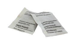 Desiccant drying paper packets Royalty Free Stock Images
