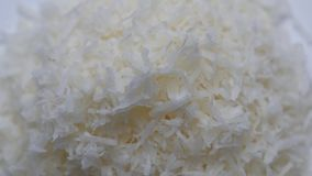 Desiccated coconut rotating on white background. stock video